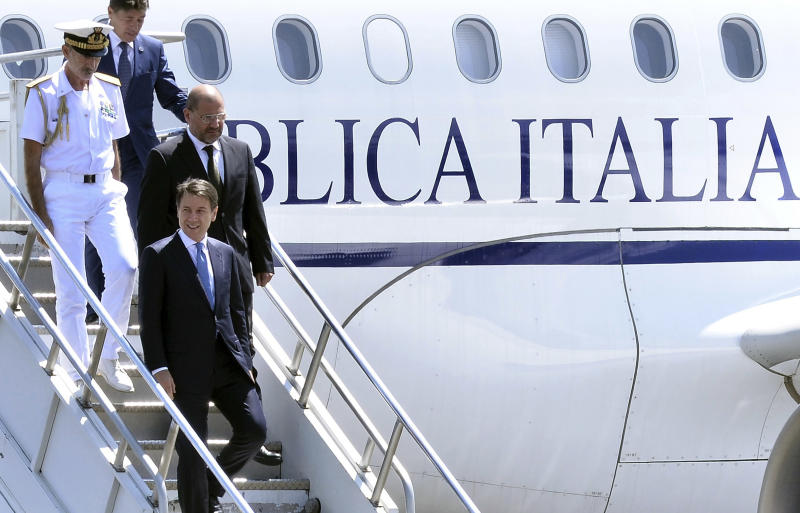 Italy's Prime Minister Giuseppe Conte, foreground, arrives at the airport in Addis Ababa, Ethiopia Thursday, Oct. 11, 2018 for a bilateral visit to the country. The two parties will have bilateral discussions on trade, investment, and other matters according to Ethiopia's Prime Minister's office. (AP Photo)