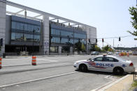 A police car is seen across from Nationals Park, Sunday, July 18, 2021, in Washington. A baseball game between the San Diego Padres and Washington was suspended in the sixth inning Saturday night after a shooting outside Nationals Park. (AP Photo/Nick Wass)