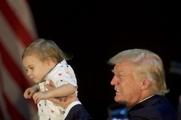 Republican presidential hopeful Donald Trump holds Tristan Murphy, 1, following a campaign event with Trump's daughter, Ivanka, at the Aston Township Community Center on Sept. 13, 2016, in Aston, Pa. (Photo: Mark Makela/Getty Images)