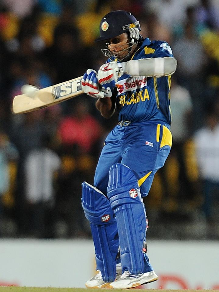 Sri Lankan batsman Mahela Jayawardene plays a shot during the third and final Twenty20 cricket match between Sri Lanka and South Africa at the Suriyawewa Mahinda Rajapakse International Cricket Stadium in the southern district of Hambantota on August 6,2013. AFP PHOTO/ LAKRUWAN WANNIARACHCHI