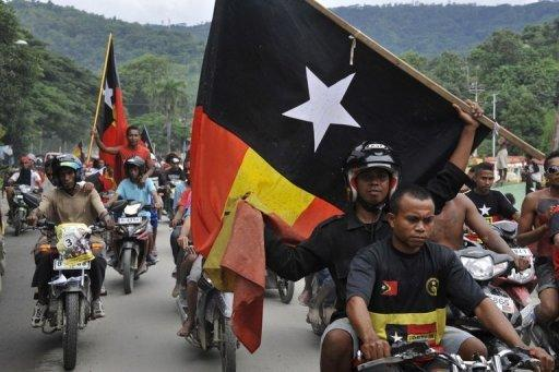 "This file photo shows Fretilin party supporters riding in a caravan as they campaign for their presidential bet Fernando ""Lu Olo"" Guterres, a former guerrilla commander, in Dili, in March. Police said on Monday that one person had been killed in demonstrations that erupted after the ruling party announced that the opposition Fretilin would be excluded from a coalition government"