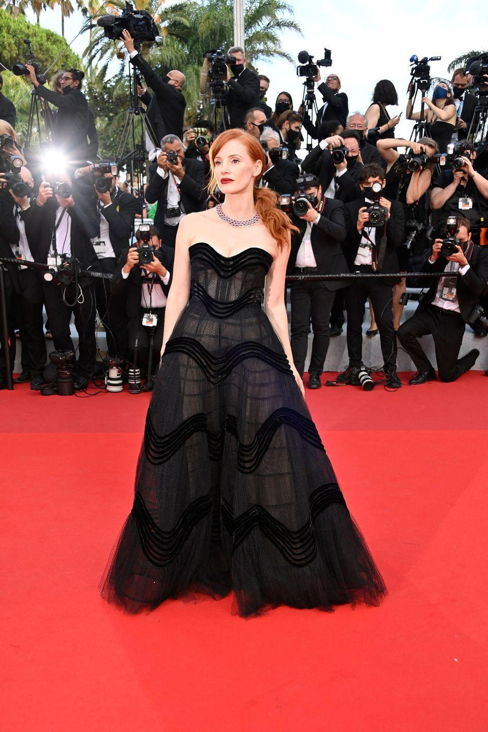 <p>Jessica Chastain walked the famous red carpet at the 2021 Opening Ceremony of the Cannes Film Festival, which also saw the premiere of movie Annette, wearing a black strapless gown. </p>