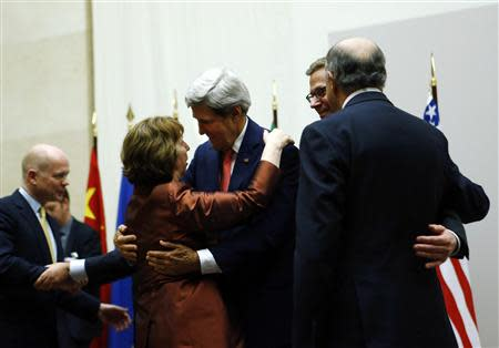 U.S. Secretary of State John Kerry (3rd R) hugs European Union foreign policy chief Catherine Ashton after she delivered a statement during a ceremony next to British Foreign Secretary William Hague (L), Germany's Foreign Minister Guido Westerwelle (R) and French Foreign Affairs Minister Laurent Fabius at the United Nations in Geneva November 24, 2013. REUTERS/Denis Balibouse