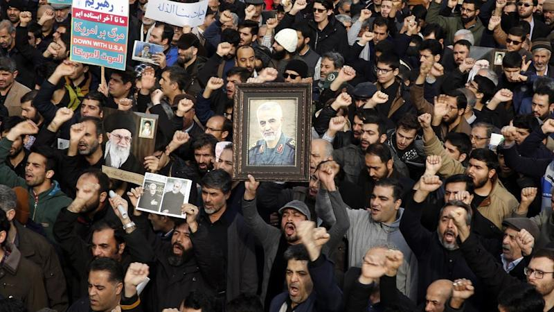 Iranians took to the streets of Tehran on Friday to mourn the death of general Qasem Soleimani