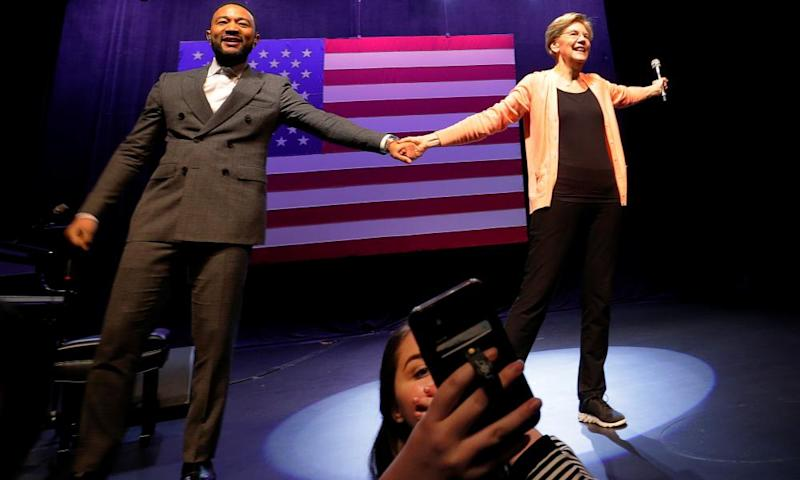Warren at a rally with celebrity supporter John Legend in Charleston.