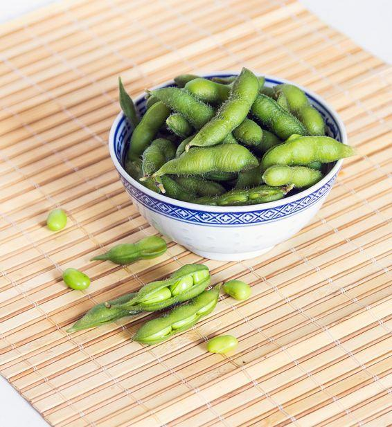 """<p>Soybeans are an excellent source of <a href=""""https://www.prevention.com/food-nutrition/healthy-eating/a20514733/high-protein-vegetables-and-plant-based-food/"""" rel=""""nofollow noopener"""" target=""""_blank"""" data-ylk=""""slk:plant-based protein"""" class=""""link rapid-noclick-resp"""">plant-based protein</a> as well as fiber. If you buy them in the shell, it prevents you from eating them too fast or overeating. Some grocery stores (like Trader Joe's) sell them frozen and pre-blanched so all you have to do is grab a handful and pop them in the microwave for a little bit or wait for them to thaw. To kick things up a notch, prep this easy <a href=""""https://www.prevention.com/food-nutrition/recipes/a20531341/sesame-edamame-with-scallions/"""" rel=""""nofollow noopener"""" target=""""_blank"""" data-ylk=""""slk:Sesame Edamame with Scallions"""" class=""""link rapid-noclick-resp"""">Sesame Edamame with Scallions</a> recipe.</p>"""