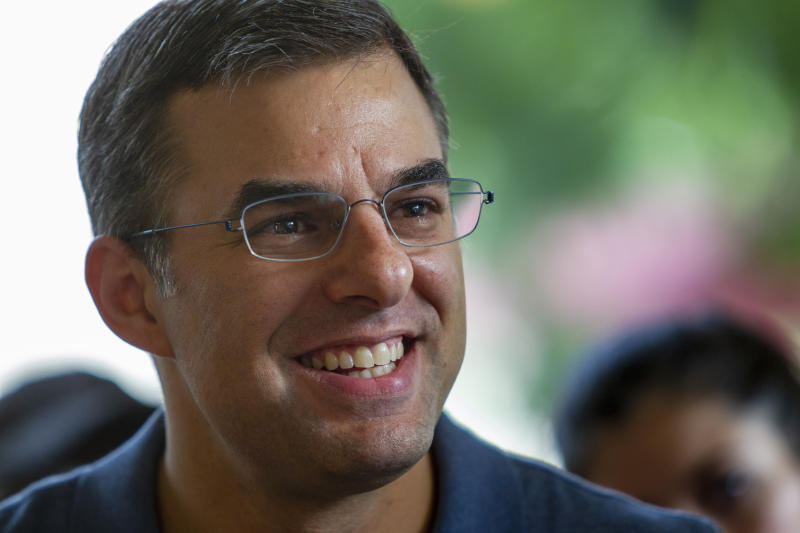 FILE - In this Aug. 21, 2019, file photo Rep. Justin Amash, I-Cascade Township, holds a constituent meeting at Rising Grinds Cafe, in Grand Rapids, Mich. Amash, a Trump critic, said Saturday, May 16, 2020, that he has decided not to seek the Libertarian nomination to run for president. (Cory Morse/The Grand Rapids Press via AP, File)