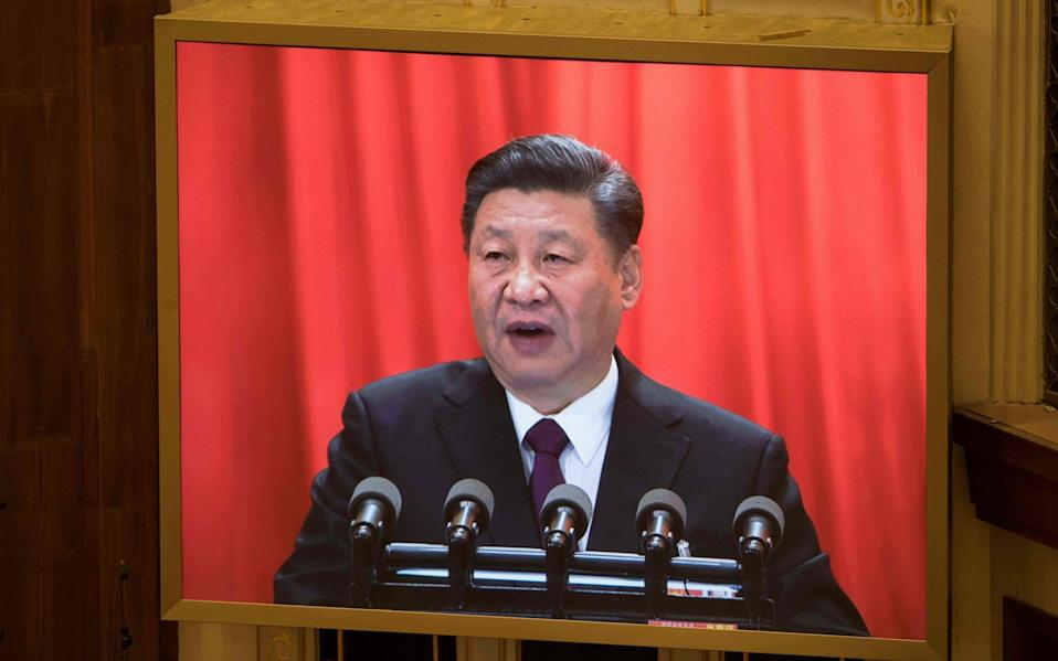 A live image of China's President Xi Jinping is seen on a screen as he delivers a speech during the closing session of the National People's Congress at the Great Hall of the People in Beijing on March 20 - AFP