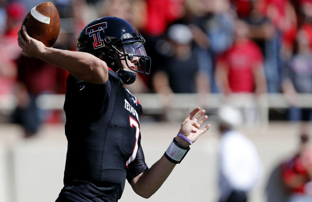 Texas Tech's Davis Webb (7) throws a pass against Iowa State during their NCAA college football game in Lubbock, Texas, Saturday, Oct. 12, 2013. (AP Photo/Lubbock Avalanche-Journal, Stephen Spillman)