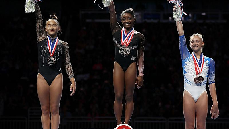 Simone Biles (centre) celebrates her title. (Photo by Jamie Squire/Getty Images)