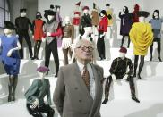 "FILE - In this May 3, 2005 file photo, French fashion designer Pierre Cardin presents his exhibition ""Design and Fashion 1950- 2005"" at the academy for arts in Vienna, Austria. France's Academy of Fine Arts says famed fashion designer Pierre Cardin has died at 98(AP Photo/Ronald Zak, File)"