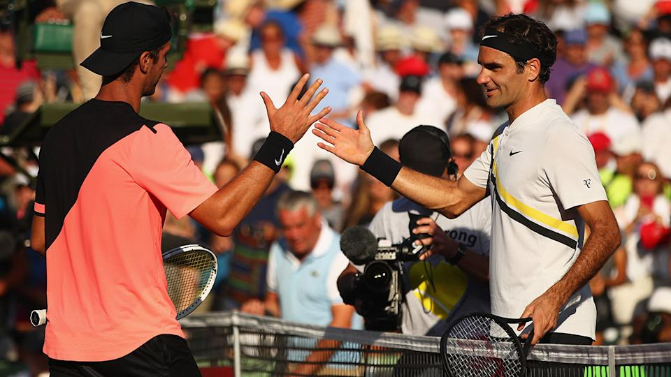 Thanasi Kokkinakis and Roger Federer, pictured here at the Miami Open in 2018.