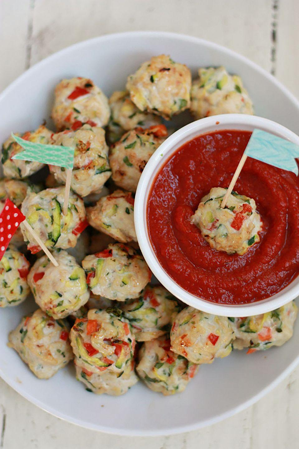 """<p>These healthy mini meatballs are perfect for dipping in marinara sauce or topping over a plate of pasta.</p><p><strong>Get the recipe at <a href=""""http://www.superhealthykids.com/pesto-chicken-veggie-meatballs/"""" rel=""""nofollow noopener"""" target=""""_blank"""" data-ylk=""""slk:Super Healthy Kids"""" class=""""link rapid-noclick-resp"""">Super Healthy Kids</a>.</strong></p>"""