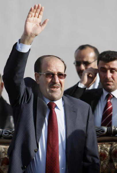 Iraq's Prime Minister Nouri al-Maliki greets supporters following a campaign rally in Basra, Iraq's second-largest city, 340 miles (550 kilometers) southeast of Baghdad, Iraq, Monday, April 15, 2013. Al-Maliki resumed his election campaign after the early voting for security forces in the country's provincial elections. (AP Photo/ Nabil al-Jurani)