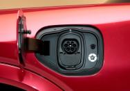 FILE PHOTO: FILE PHOTO: The charging socket is seen on Ford Motor Co's all-new electric Mustang Mach-E vehicle during a photo shoot at a studio in Warren, Michigan