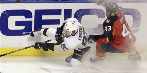 Pittsburgh Penguins' Sidney Crosby (87) falls as Florida Panthers' Mike Weaver (43) defends during the first period of an NHL hockey game, Tuesday, Feb. 26, 2013, in Sunrise, Fla. (AP Photo/Luis M. Alvarez)