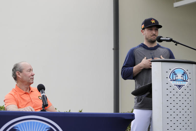 Houston Astros' Alex Bregman, right, delivers a statement as Astros owner Jim Crane listens during a news conference before the start of the first official spring training baseball practice for the team Thursday, Feb. 13, 2020, in West Palm Beach, Fla. (AP Photo/Jeff Roberson)