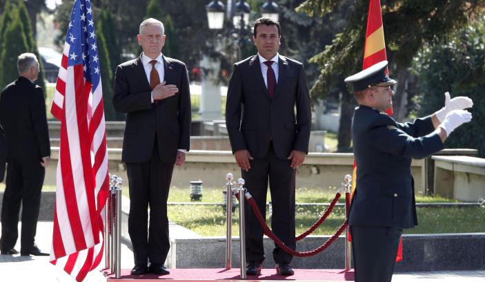 U.S. Defense Secretary James Mattis, center left, and Macedonian Prime Minister Zoran Zaev, center right, observe the national anthems during a welcome ceremony at the government building in Skopje, Macedonia, Monday, Sept. 17, 2018. Mattis arrived in Macedonia Monday, condemning Russian efforts to use its money and influence to build opposition to an upcoming vote that could pave the way for the country to join NATO, a move Moscow opposes. (AP Photo/Boris Grdanoski)