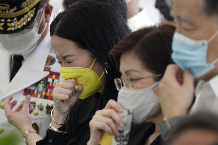 Kris Aquino, the youngest sister of former Philippine President Benigno Aquino III cries during state burial rites on Saturday, June 26, 2021, at a memorial park in suburban Paranaque city, Philippines. Aquino was buried in austere state rites during the pandemic Saturday with many remembering him for standing up to China over territorial disputes, striking a peace deal with Muslim guerrillas and defending democracy in a Southeast Asian nation where his parents helped topple a dictator. He was 61. (AP Photo/Aaron Favila)