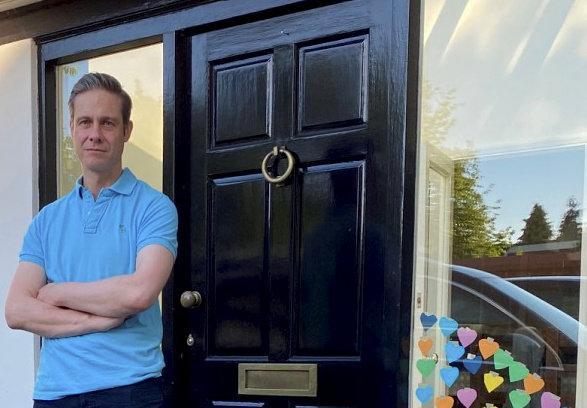 Dr Ben Noble standing outside his home in Attenborough, Nottinghamshire (Picture: SWNS)