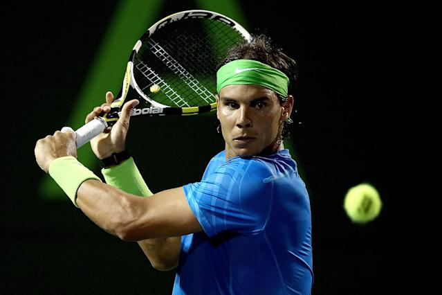 Rafael Nadal of Spain returns a shot to Santiago Giraldo of Columbia during their Sony Ericsson Open match at the Crandon Park Tennis Center, on March 23, in Key Biscayne, Florida. Nadal won 6-2, 6-0. (AFP Photo/Matthew Stockman)