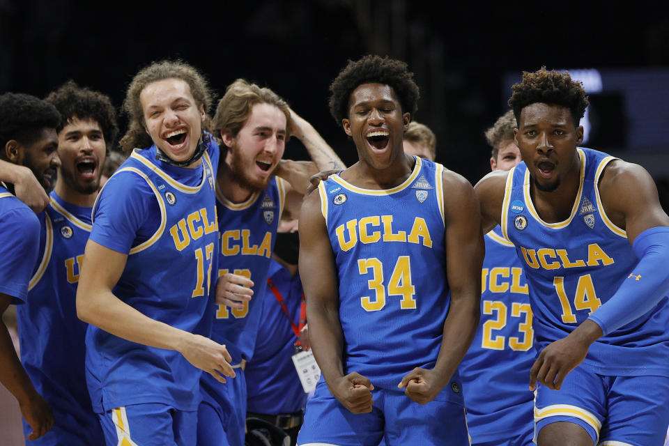 INDIANAPOLIS, INDIANA - MARCH 28: The UCLA Bruins celebrate after defeating the Alabama Crimson Tide in the Sweet Sixteen round game of the 2021 NCAA Men's Basketball Tournament at Hinkle Fieldhouse on March 28, 2021 in Indianapolis, Indiana. (Photo by Sarah Stier/Getty Images)