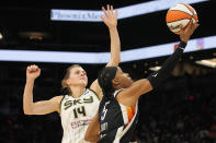 Phoenix Mercury guard Shey Peddy drives past Chicago Sky guard Allie Quigley (14) during the first half of Game 2 of basketball's WNBA Finals, Wednesday, Oct. 13, 2021, in Phoenix. (AP Photo/Rick Scuteri)