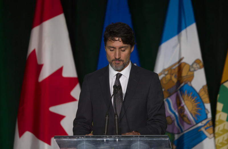 Canadian Prime Minister Justin Trudeau pauses while speaking during a memorial for the victims of the Ukrainian plane disaster in Iran this past week, in Edmonton, Alberta, Sunday, Jan. 12, 2020. (Todd Korol/The Canadian Press via AP)
