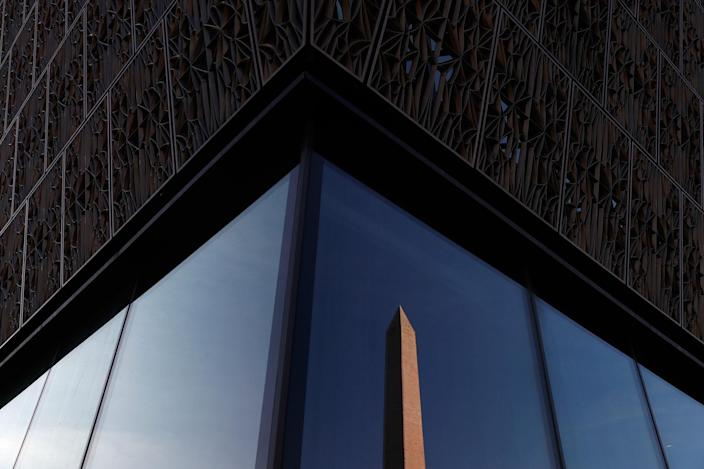 <p>The Washington Monument is reflected in the glass exterior of the National Museum of African-American History in Washington in the morning light, Tuesday, April 11, 2017. (AP Photo/Carolyn Kaster) </p>