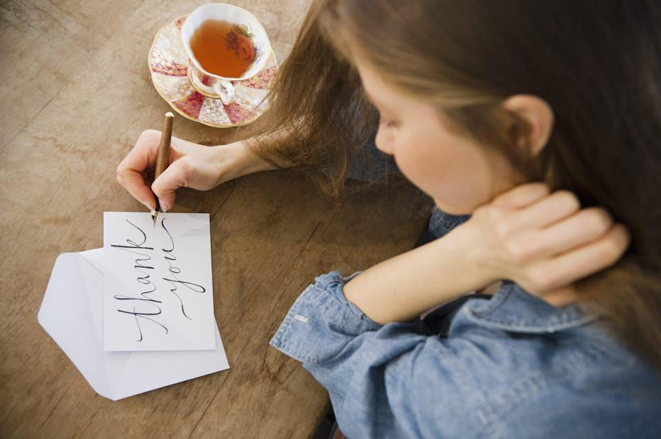 woman writing thank you note