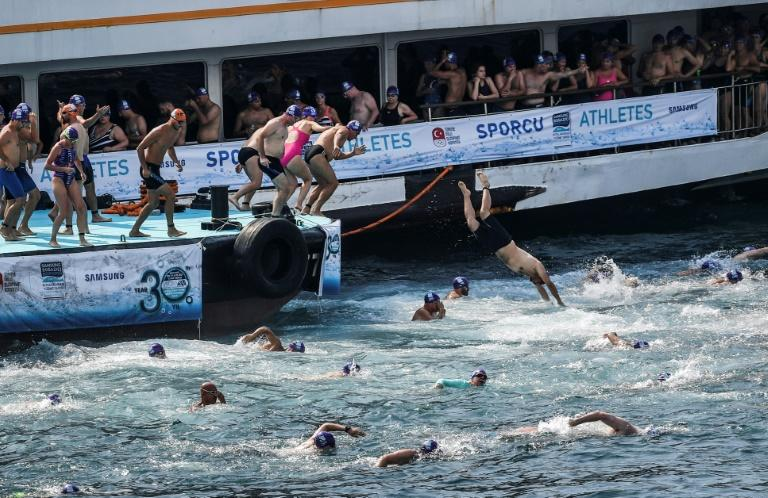 Swimmers dive into the Bosphorous Strait to take part in Istanbul's iconic cross-continental race