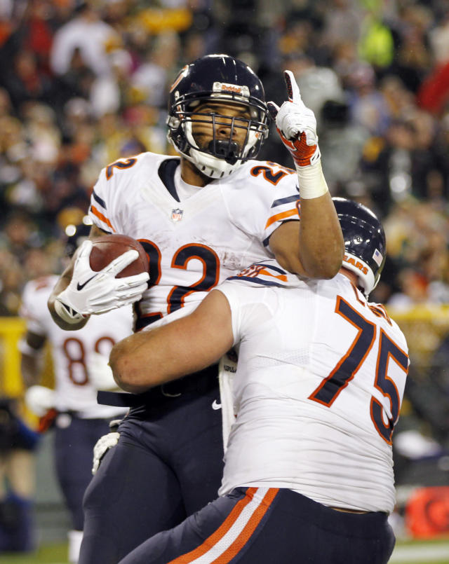 Chicago Bears' Matt Forte (22) celebrates his touchdown run with teammate Kyle Long (75) during the first half of an NFL football game against the Green Bay Packers Monday, Nov. 4, 2013, in Green Bay, Wis. (AP Photo/Mike Roemer)