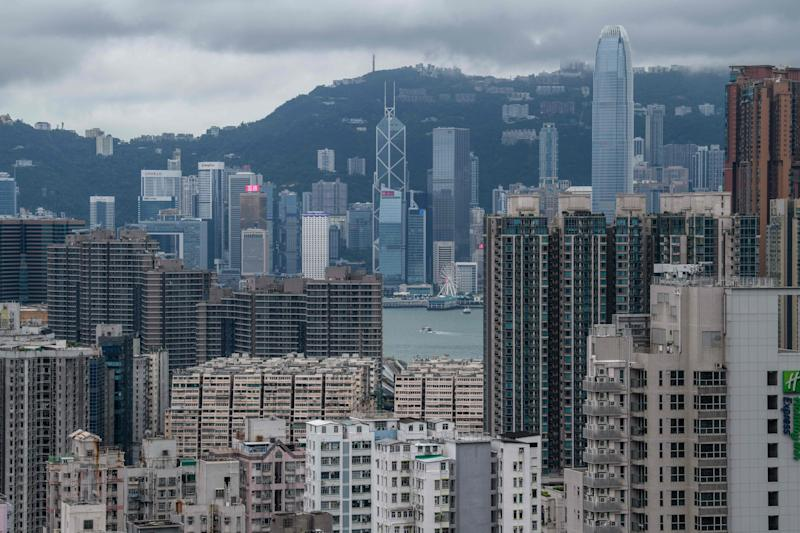 This picture taken on August 3, 2019 shows a general view of residential and commercial buildings in the Kowloon district (foreground) with the skyline of Hong Kong Island past Victoria Harbour (C) in the distance. (Photo by ANTHONY WALLACE / AFP) (Photo credit should read ANTHONY WALLACE/AFP/Getty Images)