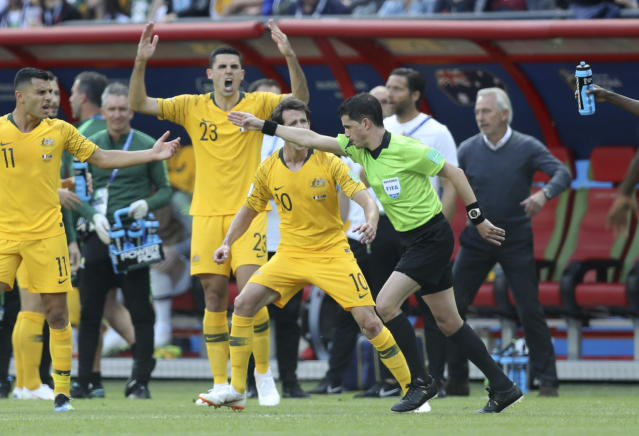 Australian players protest as referee Andres Cunha from Uruguay decides on penalty after consulting with the VAR during the group C match between France and Australia at the 2018 soccer World Cup in the Kazan Arena in Kazan, Russia, Saturday, June 16, 2018. (AP Photo/David Vincent)