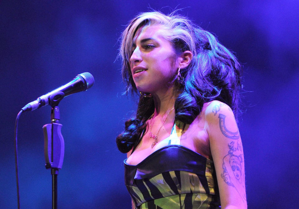Among the items up for sale is the dress Amy Winehouse wore for her last ever gig, in Serbia in 2011. (Brian Rasic/Getty Images)