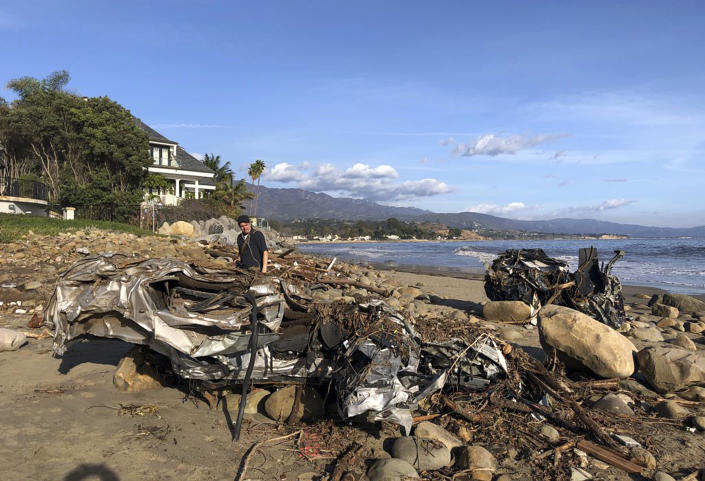 <p>The wreckage of two autos sits on the beach that were carried by floodwaters down Montecito Creek Tuesday all the way to the Pacific Ocean in Montecito, Calif., Wednesday, Jan. 10, 2018. (Photo: Mike Eliason/Santa Barbara County Fire Department via AP) </p>