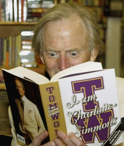 "Wolfe reads a copy of his 2004 novel ""I Am Charlotte Simmons"""
