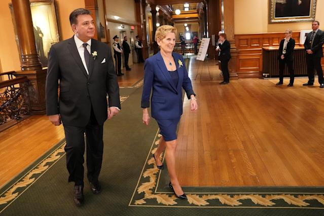 Ontario Premier Kathleen Wynne and Finance Minister Charles Sousa arrive for the reading of the new provincial budget at Queen's Park in Toronto, Ontario, Canada, March 28, 2018. REUTERS/Carlo Allegri