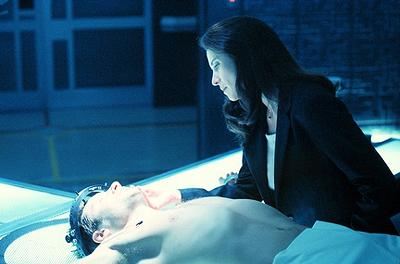 """Agent Diana Fowley (Mimi Rogers, R) plays a mysterious part in Agent Fox Mulder's (David Duchovny) deteriorating illness in """"The Sixth Extinction II: Amor Fati"""" episode of Fox's The X-Files X-Files"""