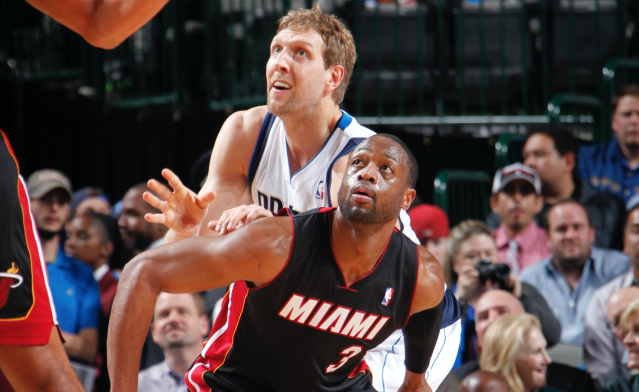 Dwyane Wade and Dirk Nowitzki battled in the 2011 NBA Finals, and now they will likely play in their final All-Star Game later this month. (Photo by Glenn James/NBAE via Getty Images)