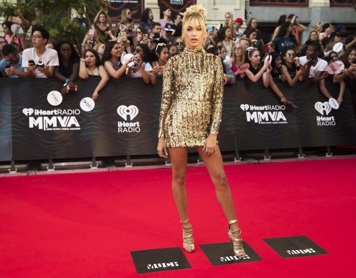 <p>The gorgeous It Girl walked the red capret in a '70s-esque sequined gold minidress. <i>(THE CANADIAN PRESS/Mark Blinch)</i><br /></p>