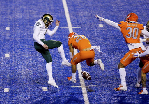 Boise State's Avery Williams (26) blocks a punt by Colorado State's Ryan Stonehouse (41) during the first quarter in an NCAA college football game Thursday, Nov. 12, 2020, in Boise, Idaho. Williams recovered the block in the end zone for a touchdown. (AP Photo/Steve Conner)