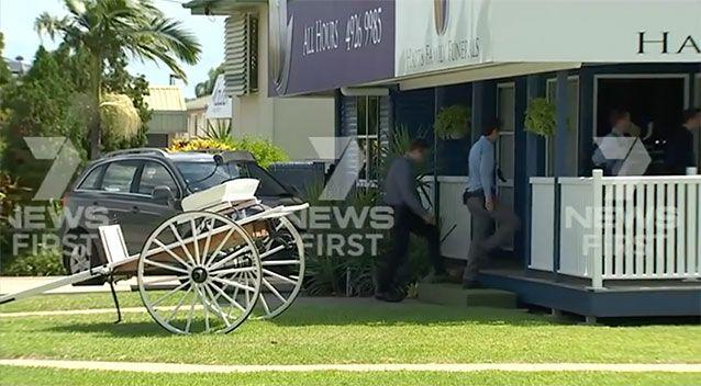 Rockhampton Detectives raided Hart's Family funerals over allegations it switched a woman's coffin. Source: 7 News