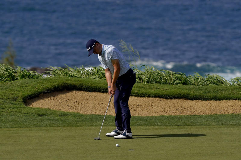 Justin Thomas putts on the 12th green during third round of the Tournament of Champions golf event, Saturday, Jan. 4, 2020, at Kapalua Plantation Course in Kapalua, Hawaii. (AP Photo/Matt York)