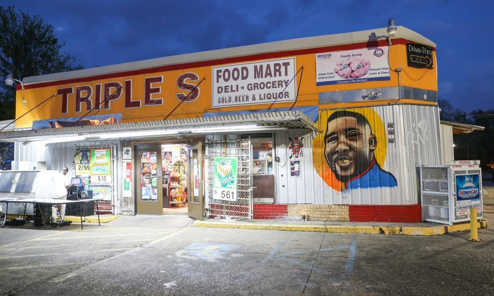 """<span class=""""element-image__caption"""">A mural in memory of Alton Sterling outside the Triple S mart. Sterling was shot six times.</span> <span class=""""element-image__credit"""">Photograph: Josh Brasted/Getty Images</span>"""