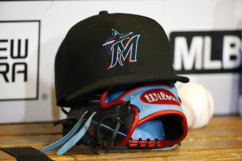 A Miami Marlins hat and glove.