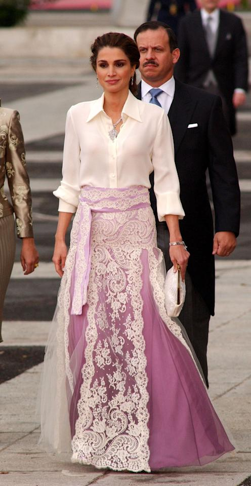 "<p>Letizia came close to being outdressed at her own <a rel=""nofollow"" title=""Latest photos and news for wedding"" href=""https://www.popsugar.com/Wedding"">wedding</a> in 2004 in Madrid, by the royal style icon she would end up being compared to most often. Queen Rania of Jordan attended the ceremony at the Almudena Cathedral in a lilac and white two-piece featuring a full-length skirt and shirt-style top. Letizia's own early gala style after her marriage bore a striking resemblance to this knockout look.</p>"