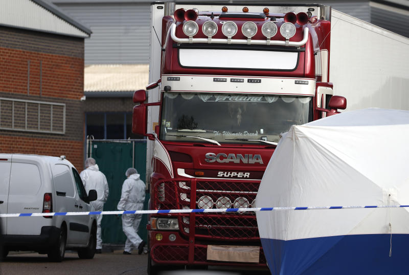 Police forensic officers inspect the lorry where the bodies were found on Wednesday. (AP Photo/Alastair Grant)
