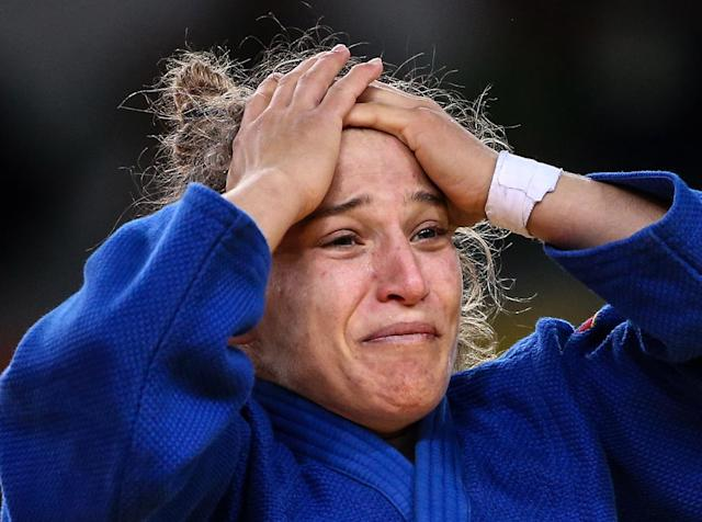 <p>Argentina's Paula Pareto celebrates defeating South Korea's Jeong Bokyeong in their women's -48 kg judo contest for Gold Medal at the 2016 Summer Olympic Games in Rio de Janeiro, Brazil, at Carioca Arena 2. Valery Sharifulin/TASS (Photo by Valery SharifulinTASS via Getty Images) </p>