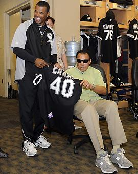 GM Ken Williams presents Muhammad Ali a Chicago White Sox jersey celebrating a special anniversary